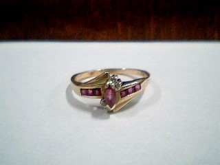 Synthetic Ruby Lady's Stone & Diamond Ring 4 Diamonds .04 Carat T.W.