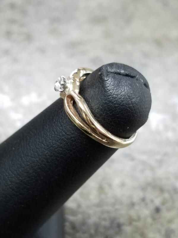 Lady's Diamond Solitaire Ring .05 CT. 14K Yellow Gold 1.05dwt