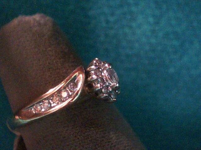 Lady's Diamond Fashion Ring 11 Diamonds .13 Carat T.W. 10K Yellow Gold 1.3dwt