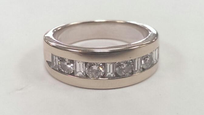 Lady's Diamond Wedding Band 9 Diamonds .60 Carat T.W. 14K White Gold 8.3g