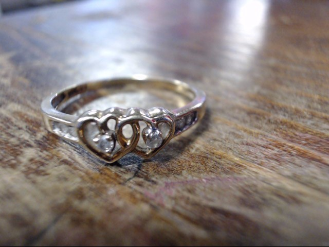 Lady's Diamond Cluster Ring 4 Diamonds .12 Carat T.W. 10K Yellow Gold 1.3g