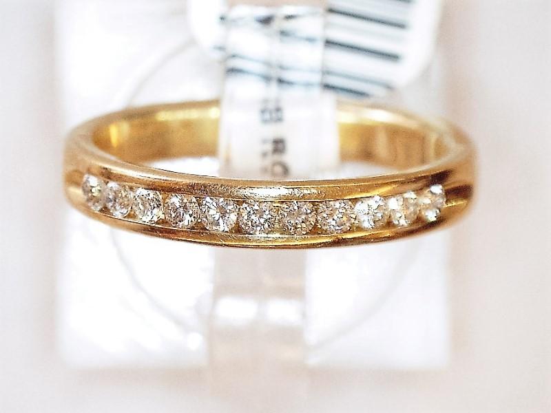 Lady's Diamond Fashion Ring 11 Diamonds .11 Carat T.W. 14K Yellow Gold 2dwt