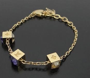 LOUIS VUITTON GAMBLE BRACELET YELLOW TONE PUPRPLE STONE
