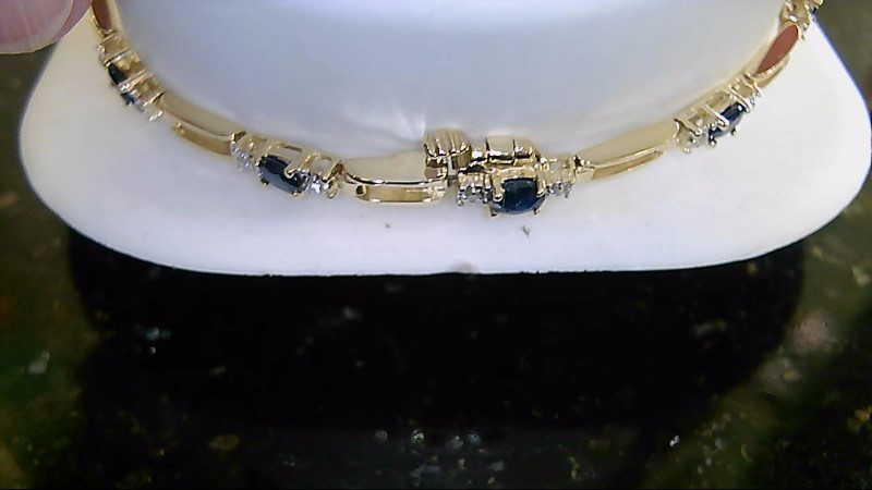 Lady's 14k yellow gold oval blue sapphire and round diamond bracelet