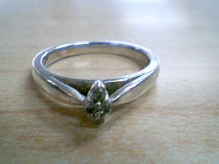 Lady's Silver-Diamond Ring 4 Diamonds .08 Carat T.W. 925 Silver 3g Size:7