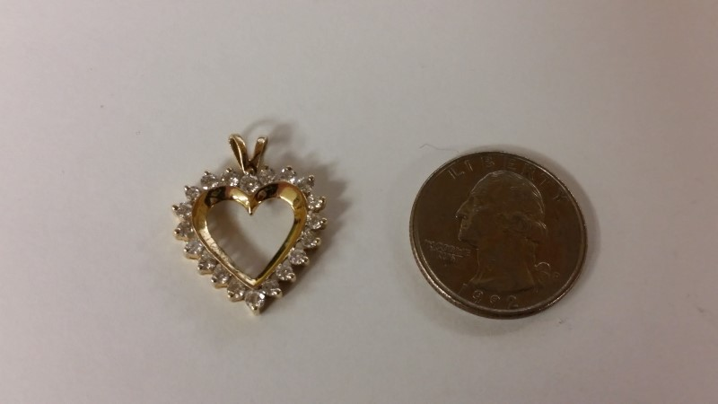 14K Yellow Gold Sparkling Halo Heart Diamond Cut Out Pendant