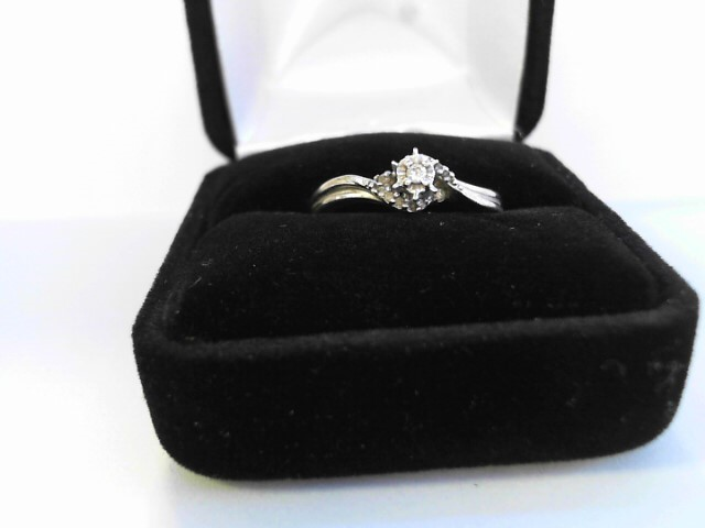 Lady's Diamond Cluster Ring .02 CT. 10K Yellow Gold 1.8dwt
