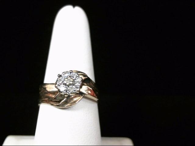 Lady's Diamond Fashion Ring 7 Diamonds .14 Carat T.W. 10K Yellow Gold 4.3g