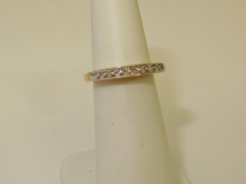 Lady's Diamond Fashion Ring 9 Diamonds .18 Carat T.W. 10K Yellow Gold 2.6g
