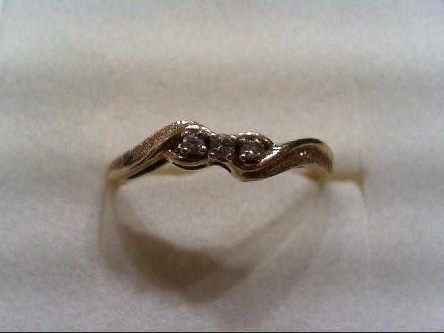 Lady's Diamond Fashion Ring 3 Diamonds .04 Carat T.W. 14K Yellow Gold 1.6g