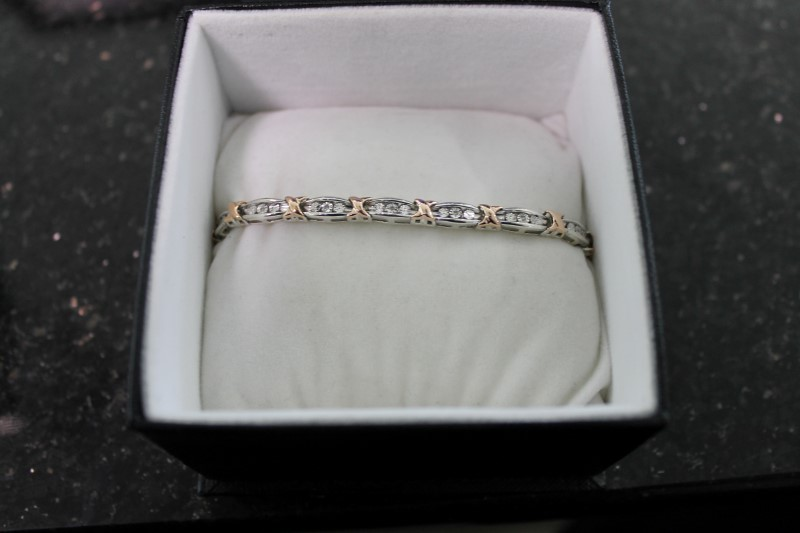 lady's sterling silver 925 with 10kyg accent diamond bracelet