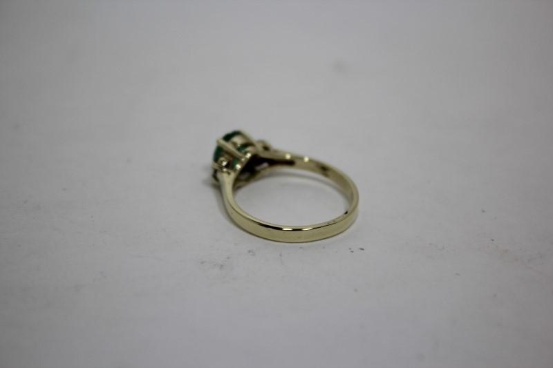 Lady's Emerald & Diamond Ring 4 Diamonds .12 CTW 14K Yellow Gold Size: 6.5