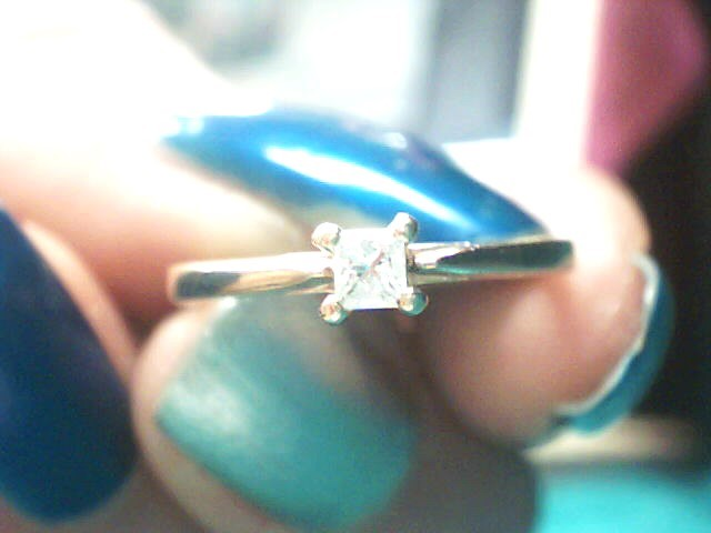 Lady's Diamond Solitaire Ring .10 CT. 14K Yellow Gold 1.1dwt