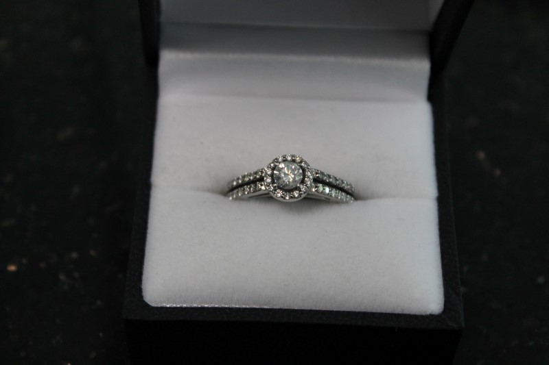 Lady's 14k white gold 1/3ct round halo wed set