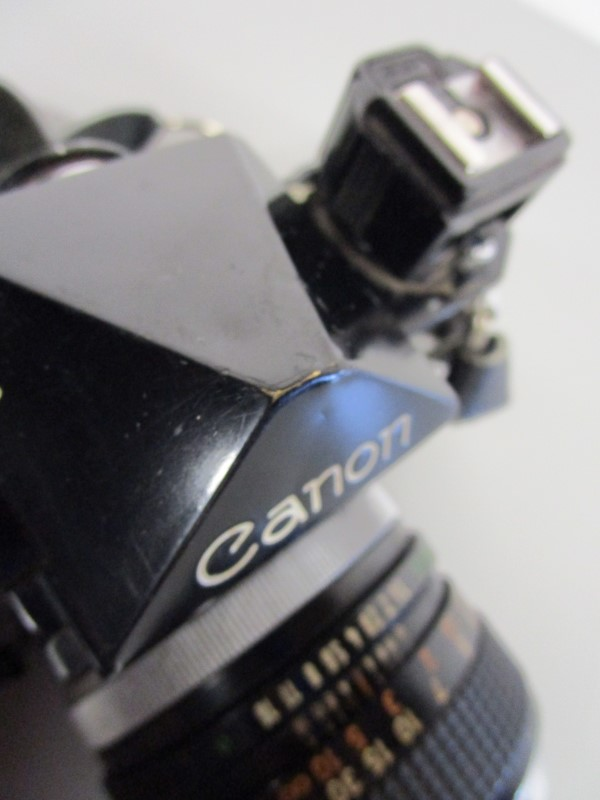 CANON F-1 35MM SLR CAMERA BUNDLE (FOUR LENSES, LEATHER STRAP/ CASE)