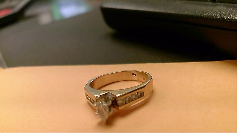 Lady's Diamond Fashion Ring 9 Diamonds .65 Carat T.W. 14K Yellow Gold 5.5g