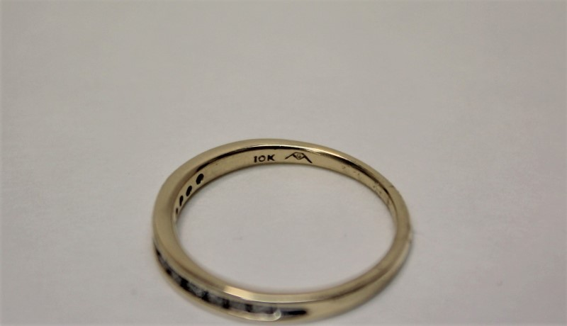 Lady's Diamond Wedding Band 12 Diamonds .24 Carat T.W. 10K Yellow Gold 1.6g