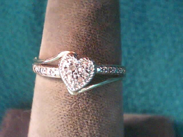 Lady's Diamond Fashion Ring 10 Diamonds .050 Carat T.W. 10K Yellow Gold 1.1dwt
