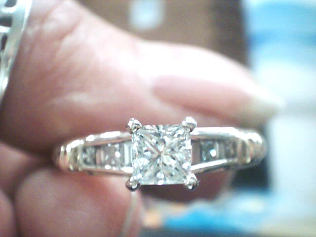 Lady's Diamond Solitaire Ring 9 Diamonds .78 Carat T.W. 14K Yellow Gold 3dwt
