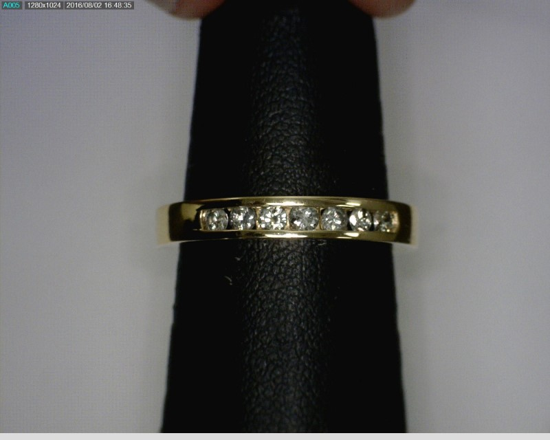Lady's Diamond Wedding Band 7 Diamonds .14 Carat T.W. 14K Yellow Gold 2.75dwt