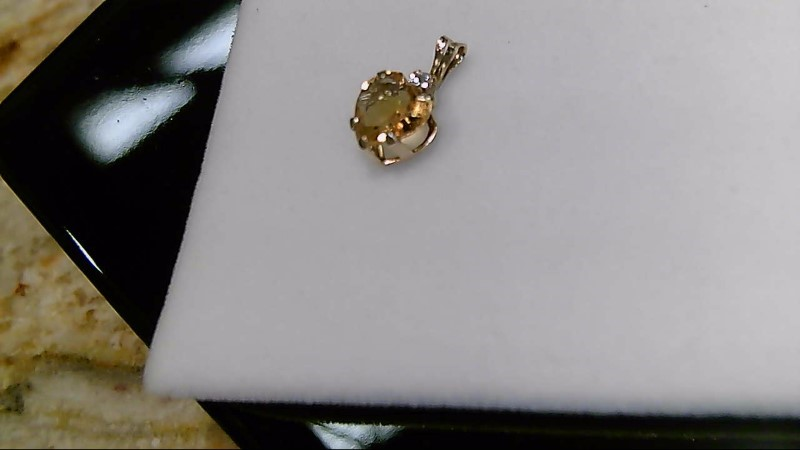Lady's 10k yellow gold heart citrine with round cubic zircornia pendant