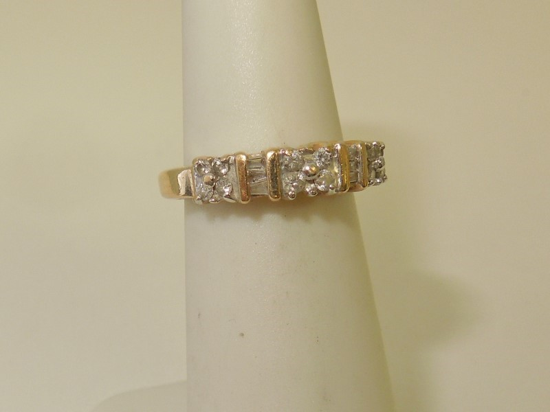 Lady's Diamond Fashion Ring 18 Diamonds .22 Carat T.W. 14K Yellow Gold 2.5g