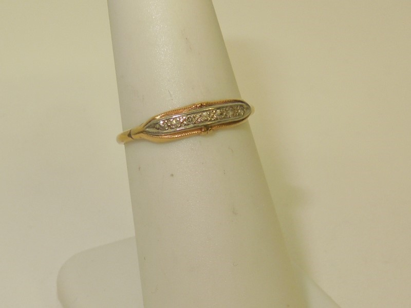 Lady's Diamond Fashion Ring 7 Diamonds .021 Carat T.W. 14K 2 Tone Gold 1g