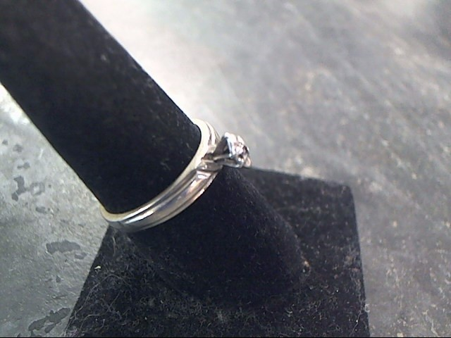 Lady's Silver-Diamond Ring .10 CT. 925 Silver 2.3dwt