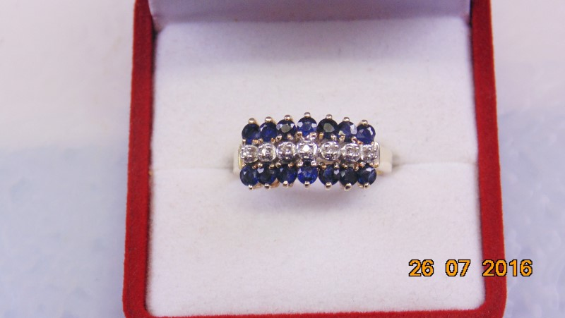 Synthetic Sapphire Lady's Stone & Diamond Ring 7 Diamonds .14 Carat T.W.