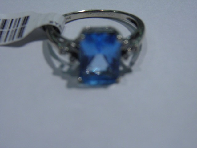 Synthetic Blue Topaz Lady's Stone & Diamond Ring 6 Diamonds .12 Carat T.W.
