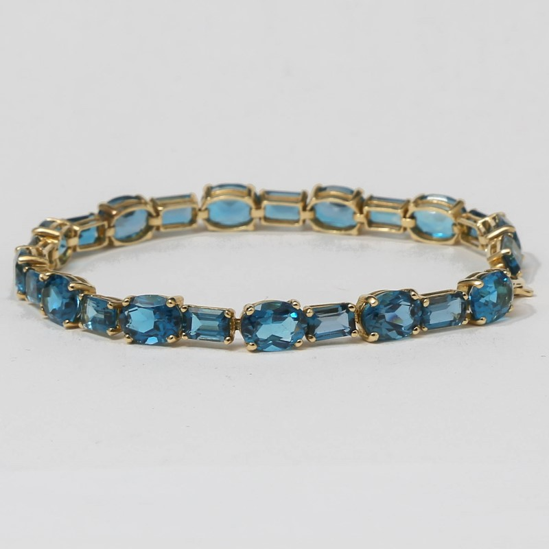 "7"" 10K Yellow Gold Blue Topaz Bracelet"