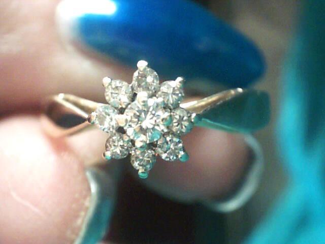 Lady's Diamond Fashion Ring 10 Diamonds .13 Carat T.W. 14K Yellow Gold 1.4dwt