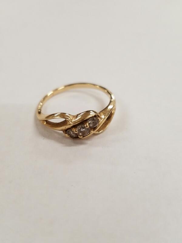 Lady's Diamond Fashion Ring 3 Diamonds .60 Carat T.W. 10K Yellow Gold 1.4g