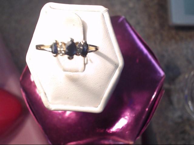 Sapphire Lady's Stone & Diamond Ring 4 Diamonds .12 Carat T.W. 14K Yellow Gold
