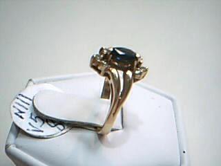 Blue Stone Lady's Stone & Diamond Ring 6 Diamonds .12 Carat T.W.