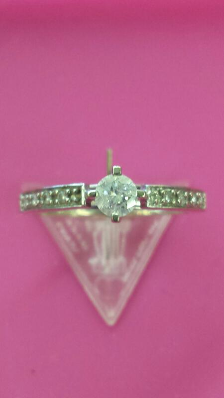 Lady's Diamond Solitaire Ring 9 Diamonds .28 Carat T.W. 10K White Gold 0.99dwt