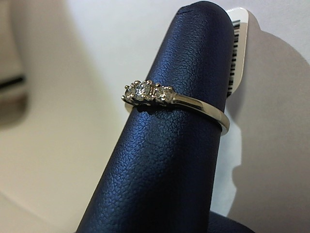 Lady's Diamond Fashion Ring 3 Diamonds .20 Carat T.W. 14K White Gold 2.4g