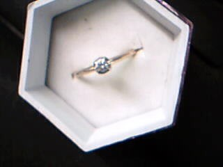 Lady's Diamond Solitaire Ring .08 CT. 14K Yellow Gold 1.41g