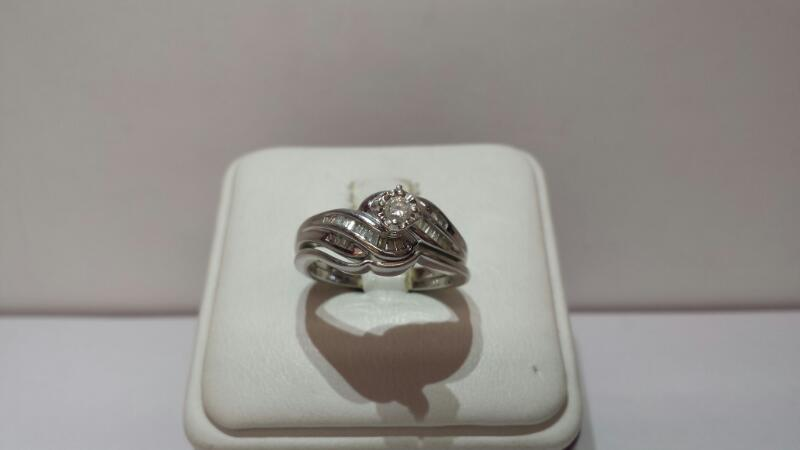 10k White Gold Ring Set with 27 Diamonds at .60ctw - 3.3dwt - Size 7