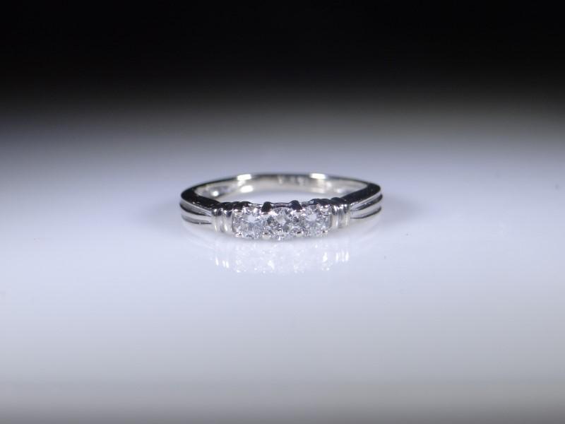 Lady's Diamond Fashion Ring 3 Diamonds .11 Carat T.W. 14K White Gold 1.87g