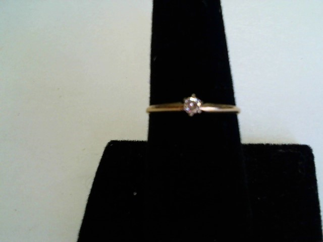 Lady's Diamond Solitaire Ring .10 CT. 10K Yellow Gold 1.09g Size:7.5