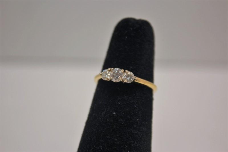 Lady's Diamond Fashion Ring 3 Diamonds .58 Carat T.W. 14K Yellow Gold 2.6g