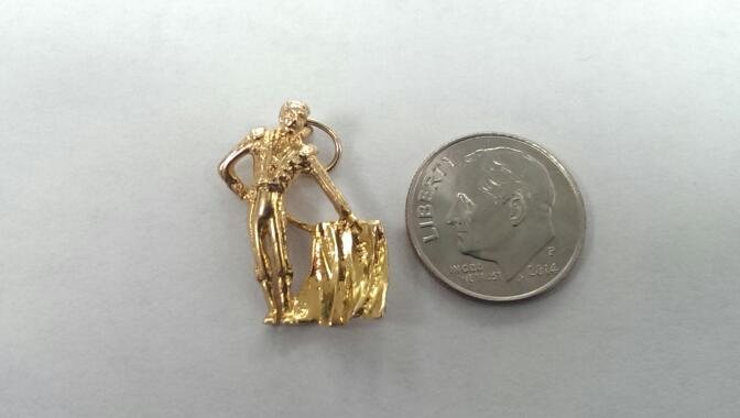 MATADOR 14K YELLOW GOLD CHARM, 2.8 GRAMS