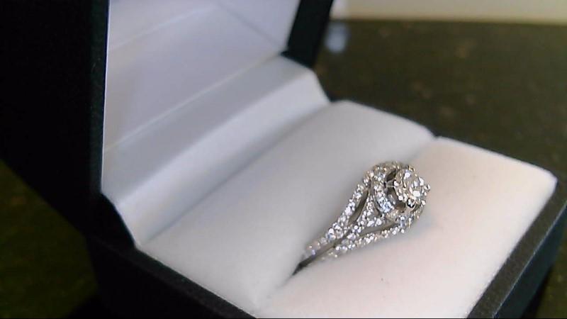 Lady's 14k white gold apx. .35ct round diamond center with surrounding round dia
