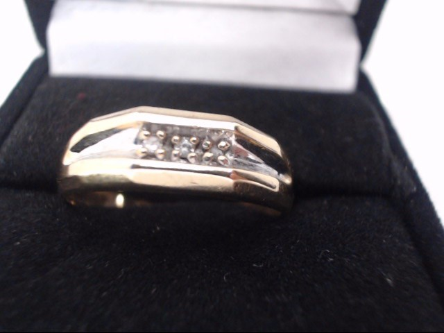 Lady's Diamond Wedding Band 3 Diamonds .06 Carat T.W. 10K Yellow Gold 2.9g