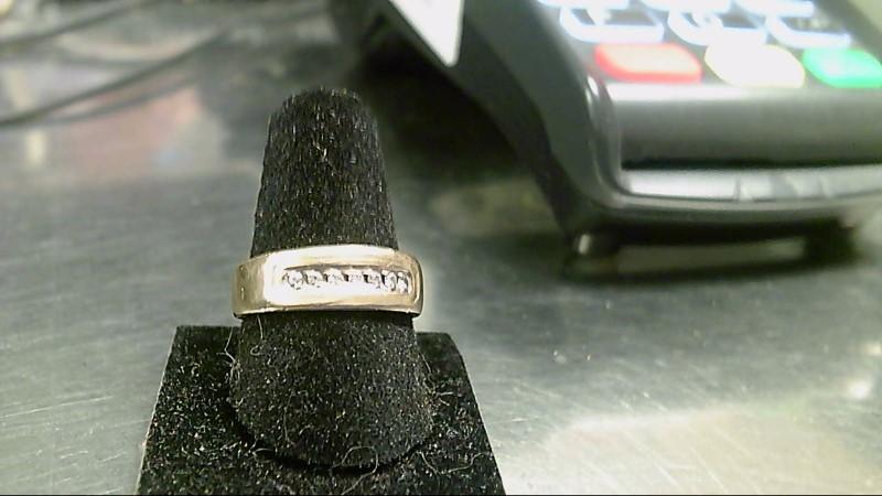 Lady's Diamond Cluster Ring 7 Diamonds .14 Carat T.W. 14K Yellow Gold 3.8g