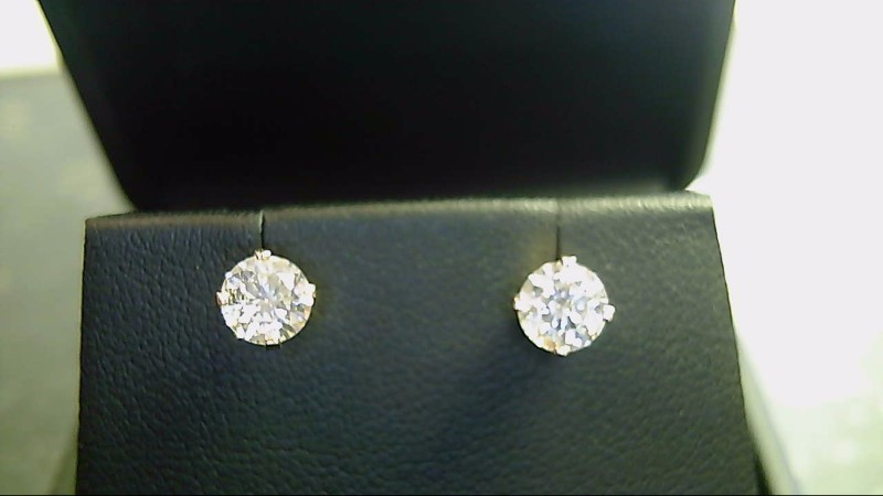 lady's 14k yellow gold apx. (.94cttw) round diamond stud earrings