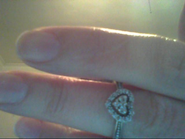 Lady's Diamond Fashion Ring 15 Diamonds .18 Carat T.W. 10K White Gold 2.4g