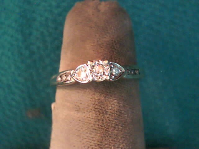 Lady's Diamond Engagement Ring 9 Diamonds .15 Carat T.W. 10K Yellow Gold 1.4dwt