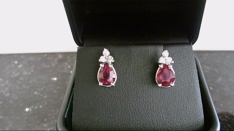 Lady's 14k white gold genuine pear ruby and round diamond earrings